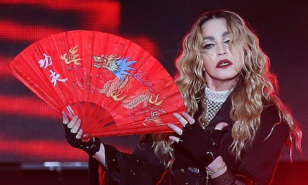 Suing Madonna – Pulling down fan's top 'could be sexual assault'