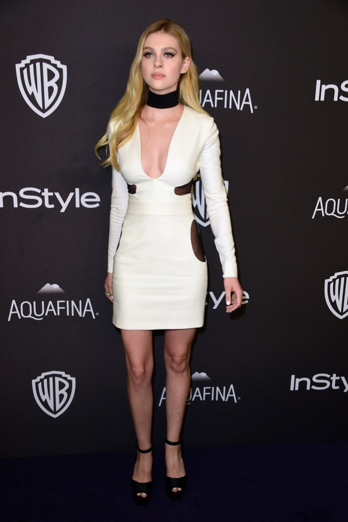 0e72a05aec1c3 Nicola Peltz paired her black-and-white Tom Ford mini dress with black  satin Giuseppe Zanotti Betty platform sandals. Getty Images.