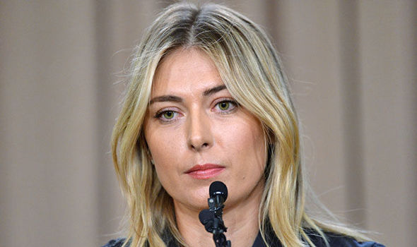 Maria Sharapova looks dejected after announcing that she failed a drugs test at the Australian Open