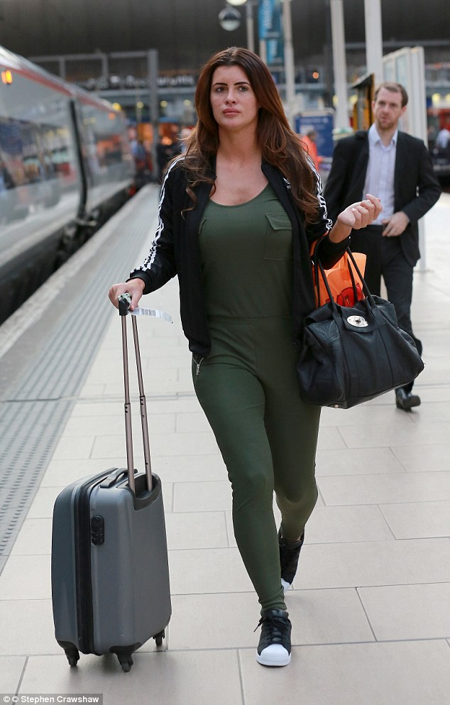 Low-key: Ahead of her first TV appearance since the news of a gagging order was uncovered, Helen Wood cut a sombre figure as she boarded a train from Manchester Piccadilly station on Thursday