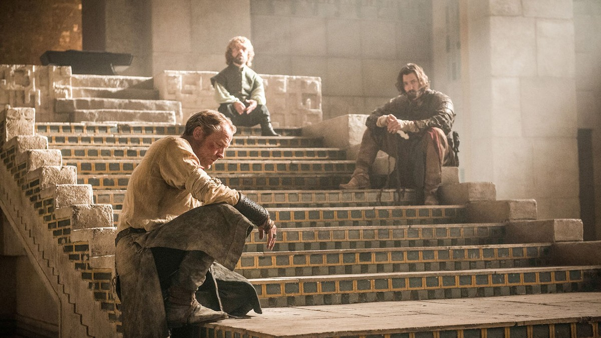 After the attack on the fighting pits by the Sons of the Harpy and Daenerys's winged departure, Meereen is left without a leader. Here, Tyrion Lannister, Jorah Mormont and Daario Naharis lay out their plan to find their queen. Credits: HBO