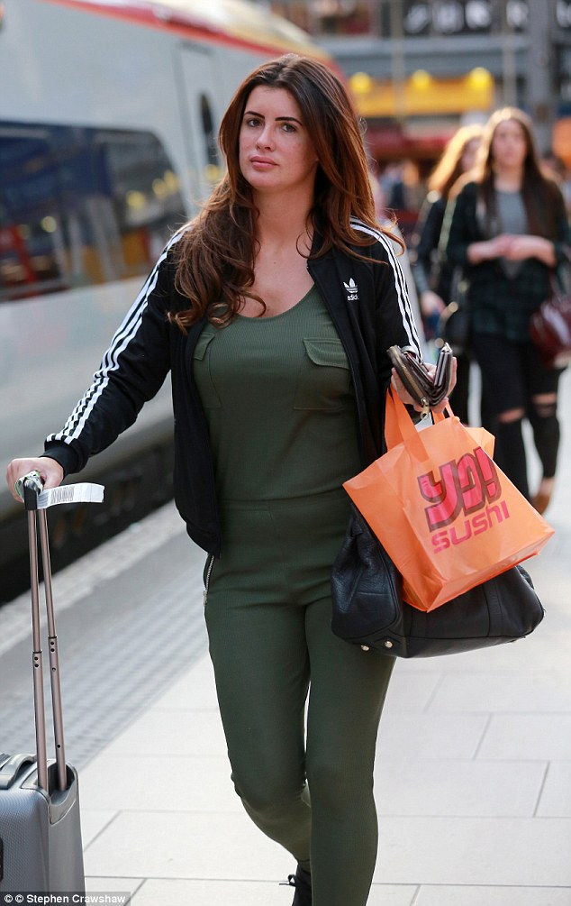 Keeping it casual: Wood - who won Big Brother in 2014 - kept her ensemble low-key for the outing, slipping her famous figure into a khaki tracksuit and layering up in a black Adidas tracksuit